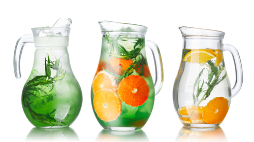 Collection of glass pitchers with tarragon infused detox water