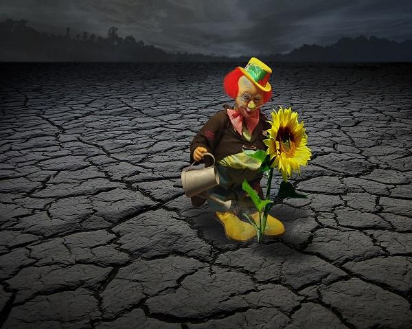 clown on cracked earth