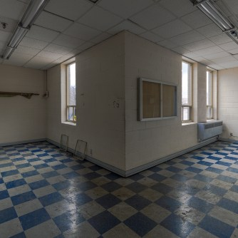 checkerboard floors in abandoned ontario building by freaktography