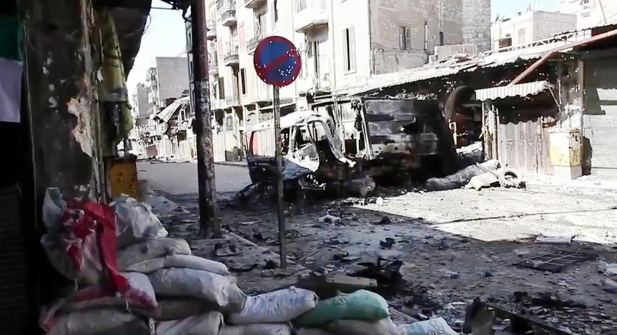 Bombed out vehicles, Aleppo,Scott Bobb, Voice of America News