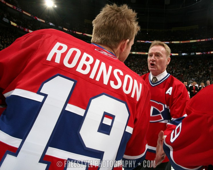 OTTAWA - NOVEMBER 19: Larry Robinson shakes hands with Mike Komisarek #8 of the Montreal Canadiens during Robinson's #19 jersey retirement ceremony before a game against the Ottawa Senators at the Bell Centre on November 19, 2007 in Montreal, Quebec, Canada. (Photo by Andre Ringuette/NHLI via Getty Images) *** Local Caption *** Larry Robinson;Mike Komisarek
