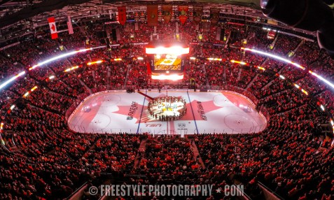 OTTAWA, ON - OCTOBER 25: In a coordinated tribute with NHL games in Montreal and Toronto to honor Canadian soldiers who lost their lives this past week, members of the Ottawa Senators and the New Jersey Devils stand together for the national anthems at Canadian Tire Centre on October 25, 2014 in Ottawa, Ontario, Canada. (Photo by Andre Ringuette/NHLI via Getty Images) *** Local Caption ***
