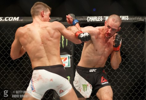 OTTAWA, ON - JUNE 18: Rory MacDonald punches Stephen Thompson in their welterweight bout during the UFC Fight Night event inside the TD Place Arena on June 18, 2016 in Ottawa, Ontario, Canada. (Photo by Andre Ringuette/Zuffa LLC/Zuffa LLC via Getty Images)