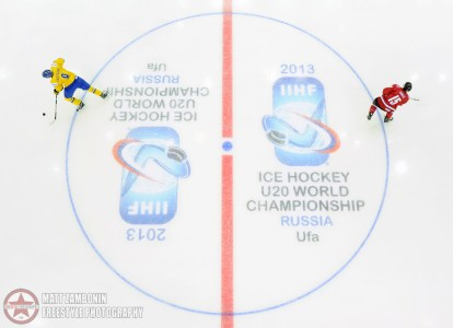 Sweden's Mikael Vikstrand #9 and Switzerland's Mike Kunzle #15 skate during the warm up period prior to the preliminary round game between team Sweden and team Switzerland at the 2013 IIHF Ice Hockey U20 World Championship. (Photo by Matt Zambonin/HHOF-IIHF Images)