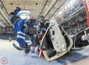 Finland's Jenni Hiirikoski #6 falls over Czech Republic's Klara Peslarova #29 at Czech RepublicÕs net during quarterfinal round action at the 2016 IIHF Ice Hockey Women's World Championship. (Photo by Matt Zambonin/HHOF-IIHF Images)