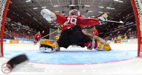 Team Sweden gets the puck past Switzerland's Gauthier Descloux #29 for their fourth goal of the game during preliminary round action at the 2016 IIHF World Junior Championship. (Photo by Matt Zambonin/HHOF-IIHF Images)