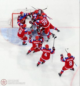 Team Russia celebrates after defeating Team USA 2-1 during semifinal round action at the 2016 IIHF World Junior Championship. (Photo by Matt Zambonin/HHOF-IIHF Images)