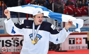 Finland's Kasperi Kapanen #24 waves Finland's flag during gold medal game action at the 2016 IIHF World Junior Championship. (Photo by Matt Zambonin/HHOF-IIHF Images)
