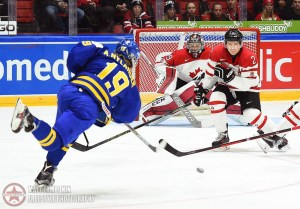 Sweden's Alexander Nylander #19 fires a shot on Canada's Mackenzie Blackwood #29 with Joe Hicketts #2 and Travis Konecny #17 in front during preliminary round action at the 2016 IIHF World Junior Championship. (Photo by Matt Zambonin/HHOF-IIHF Images)