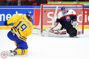 Sweden's Alexander Nylander #19 fires a shot on Slovakia's Adam Huska #30 during quarterfinal round action at the 2016 IIHF World Junior Championship. (Photo by Matt Zambonin/HHOF-IIHF Images)