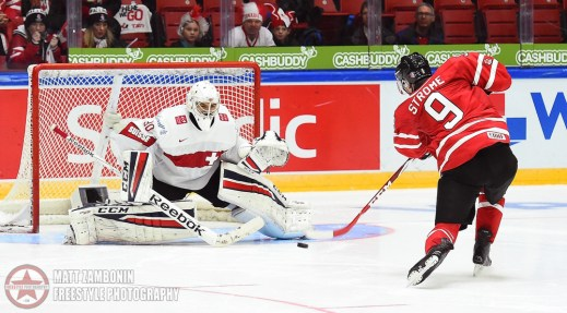 Switzerland's Joren Van Pottelberghe #30 makes a save off a shot from Canada's Dylan Strome #9 in a shootout during preliminary round action at the 2016 IIHF World Junior Championship. (Photo by Matt Zambonin/HHOF-IIHF Images)