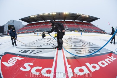 OTTAWA, ON - DECEMBER 10: Ice crew members install the center ice logo ahead of the Scotiabank NHL100 Classic between the Ottawa Senators and the Montreal Canadiens, at Lansdowne Park on December 10, 2017 in Ottawa, Canada. (Photo by Andre Ringuette/NHLI via Getty Images)