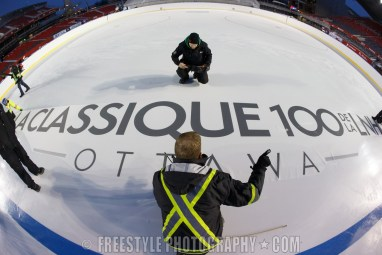 OTTAWA, ON - DECEMBER 10: Ice crew members install logos in the ice ahead of the Scotiabank NHL100 Classic between the Ottawa Senators and the Montreal Canadiens, at Lansdowne Park on December 10, 2017 in Ottawa, Canada. (Photo by Andre Ringuette/NHLI via Getty Images)