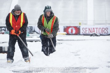 OTTAWA, ON - DECEMBER 12: Workers clear snow ahead of the Scotiabank NHL100 Classic between the Ottawa Senators and the Montreal Canadiens, at Lansdowne Park on December 12, 2017 in Ottawa, Canada. (Photo by Andre Ringuette/NHLI via Getty Images)