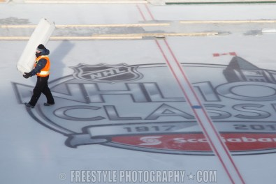 OTTAWA, ON - DECEMBER 13: A worker installs insulated covers on the ice ahead of the Scotiabank NHL100 Classic between the Ottawa Senators and the Montreal Canadiens, at Lansdowne Park on December 13, 2017 in Ottawa, Canada. (Photo by Andre Ringuette/NHLI via Getty Images)