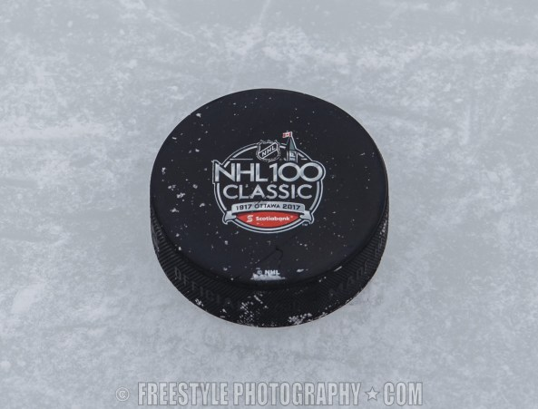 OTTAWA, ON - DECEMBER 15: A Scotiabank NHL100 Classic practice puck on the ice during an Ottawa Senators practice session at Lansdowne Park on December 15, 2017 in Ottawa, Canada. (Photo by Andre Ringuette/NHLI via Getty Images)