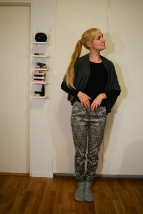 Outfit showing silver baroque print trousers, black top and socks