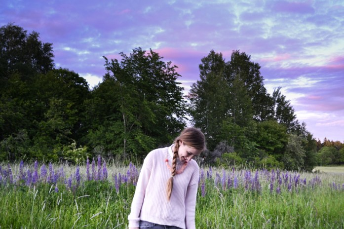 Girl in lupin field