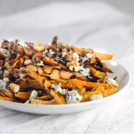 Baked Sweet Potato Fries Topped with Walnuts, Blue Cheese, and Balsamic Reduction