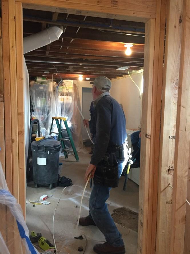 John pulling wiring to bathroom