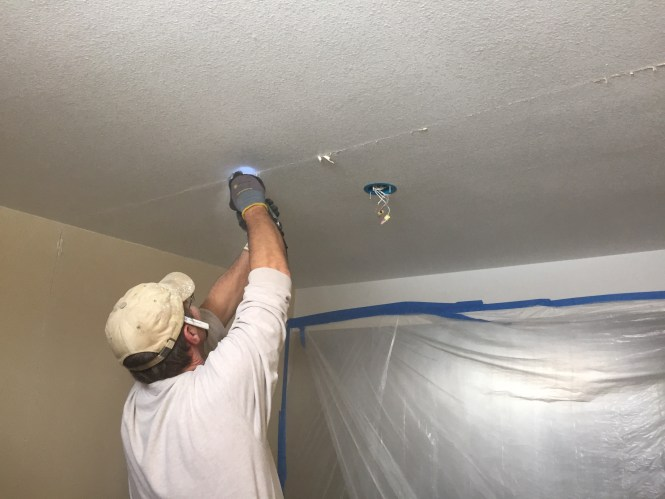 Kerry cutting into ceiling