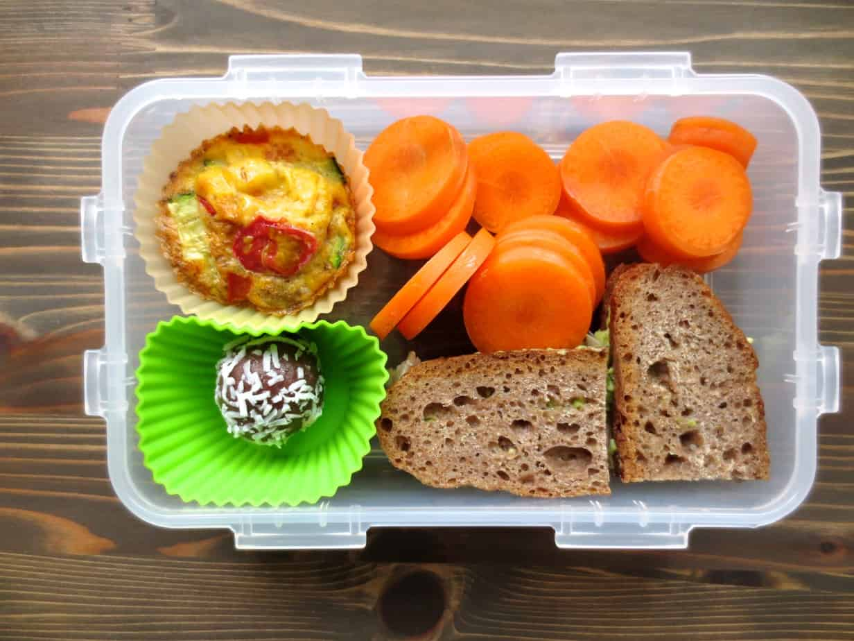 Paleo Egg Muffin, Chicken-Avocado Sandwich on Homemade Whole Wheat Bread, Carrots, PB Coconut Bite