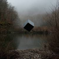 A Black Cube Floating in Nature