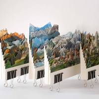Layered Landscapes in Relief Created with Old Postcards