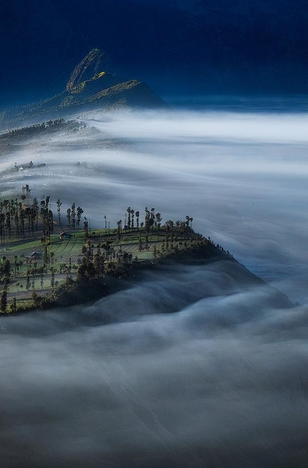 Mist fills the caldera at dawn at Mount Bromo, Indonesia.  Fuji X-T10 & XF55-200mm