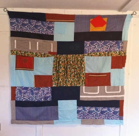 Neno's Apron Quilt, hanging in my Studio Barn at Old Bedlam Farm