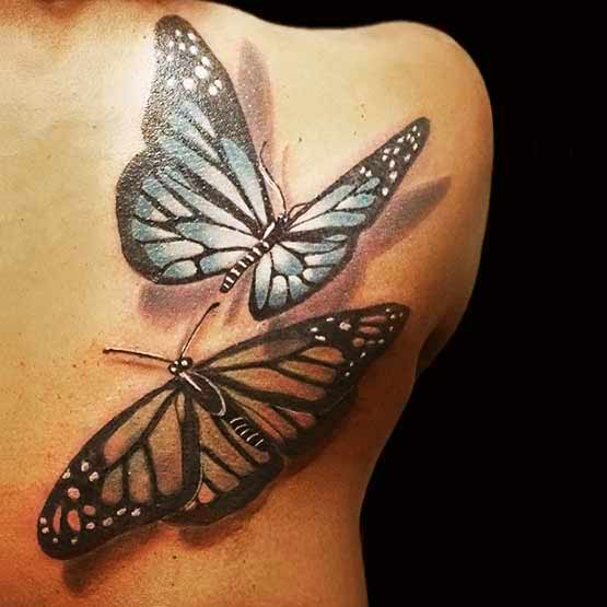 2 Butterfly Tattoos On The Back