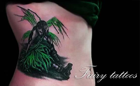 Green Fairy Tattoos Designs On Lower Back