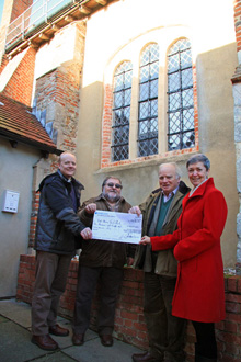 Committee Members Jan Lawler and Richard Taylor present a cheque for £4809.65 to Rector Sam Norton and Church Treasurer, Roland Gardener, covering the costs for the building restorative work to the South Aisle window – one of our first sponsored projects.