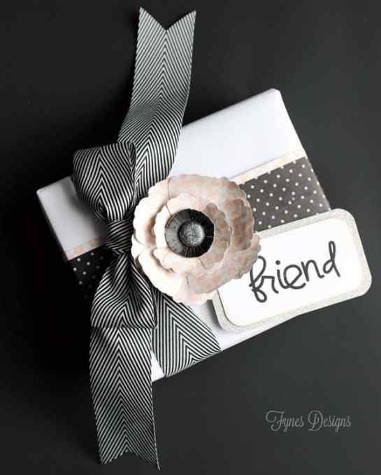 Gift wrapping idea- scrapbook paper, paper smooches stamps, and xyron