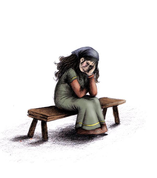 femme triste sur un banc