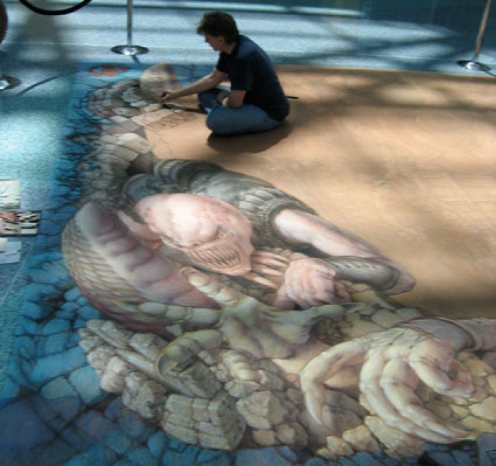 This is wenner working on the Gears painting. This is him on the very first day at work on it.