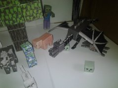 Minecraft papercraft model scene. Lots of animals, mobs and the enderdragon. Shows papercraft tree, papercraft wolf, papercraft ender dragon and more like the minecraft chicken, cow and pig from minecraft.