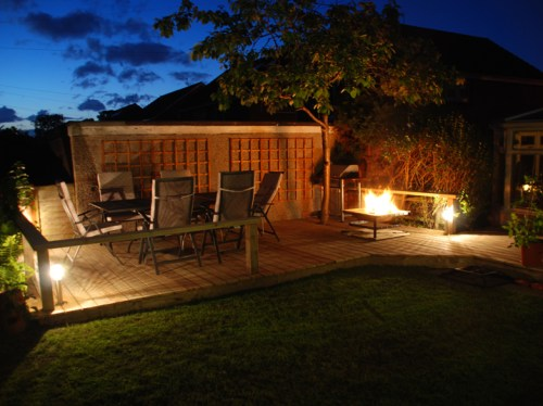 Decking with garden lights and fire pit