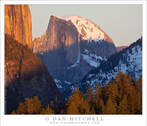 Sunset Avalanche, Half Dome - An avalanche breaks loose from the edge of Half Dome as sunset light falls over Yosemite Valley.