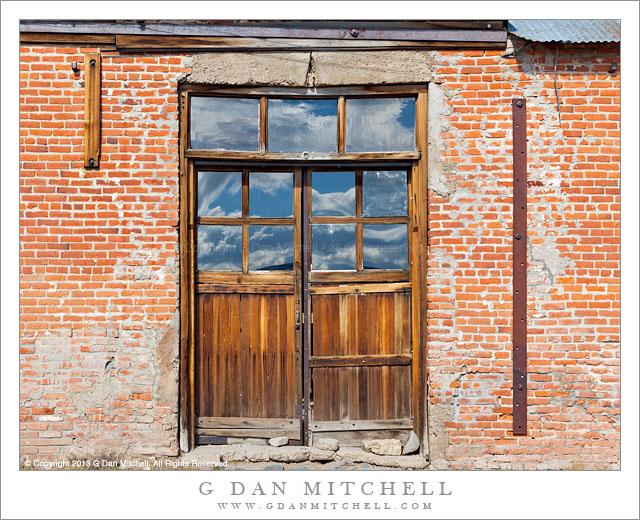 Brick Building, Doorway, Reflected Sky