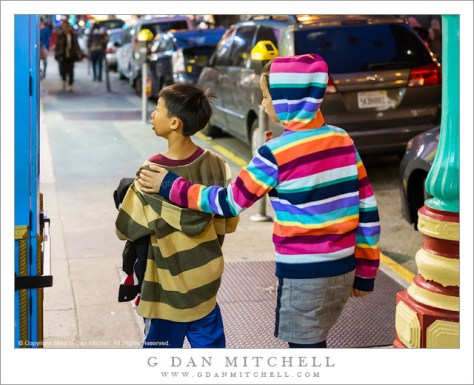 Children in Striped Hoodies
