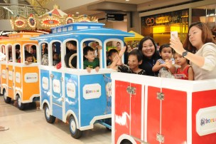 SM City Cagayan de Oro employees and kid beneficiaries spend a fun time on a train ride.