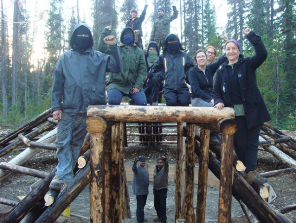 Zoe Blunt (far right) and anarchists build a structure on Crown land