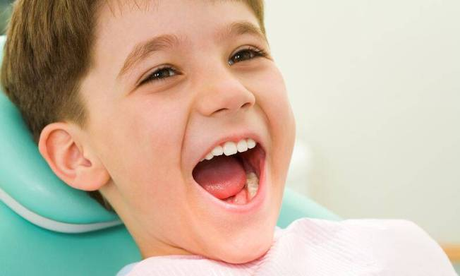 bigstock-Child-At-The-Dentistry-4955102