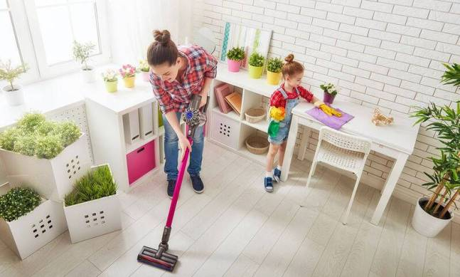 bigstock-Happy-family-cleans-the-room-121920704