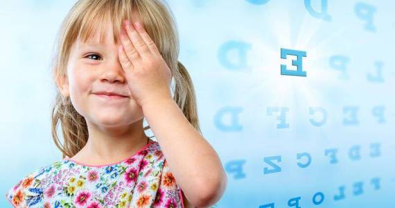 bigstock-Little-Girl-Reading-Eye-Chart-106932557
