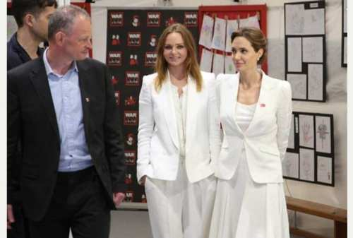 Photo of Rob Williams with Angelina Jolie and Stella McCartney, on Tuesday 10 June, during the global summit to end sexual violence in conflict. Picture War Child UK