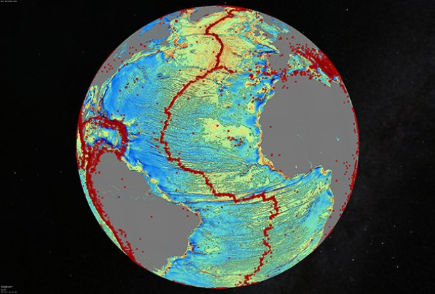 North Atlantic (gravity anomaly) Marine gravity model of the North Atlantic (10 mGal contours). Red dots show locations of earthquakes with magnitude > 5.5 and they highlight the present-day location of the seafloor spreading ridges and transform faults. This gravity information shows the details of the plate tectonic history of the rifting of these continents including the subtle signatures of fracture zones that are currently buried by sediment.
