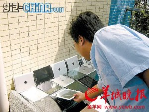 ipad 2 smuggling china 300x225 Hong Kong iPad Smugglers Get Creative With An iPulley and iCrossbow!