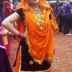 mela-gir-orange-sari-179x300